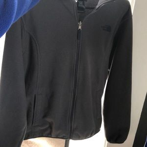 grey north face fleece with blue lettering